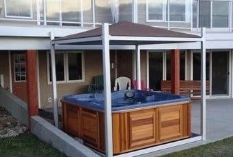 arctic spas hot tub on patio with cover