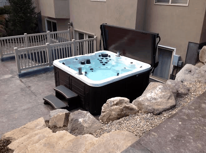 arctic spas hot tub next to a house